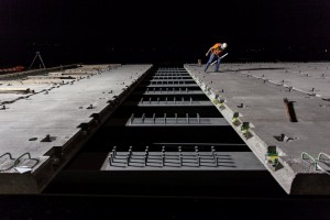 Prestressed full depth precast deck