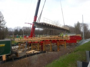 Lowering new WB girder onto temporary supports in staging area
